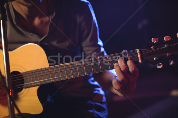 Mid section of male guitarist at music concert Stock photo © wavebreak_media