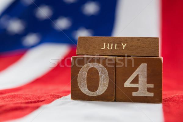 Date blocks on American flag with 4th july theme Stock photo © wavebreak_media