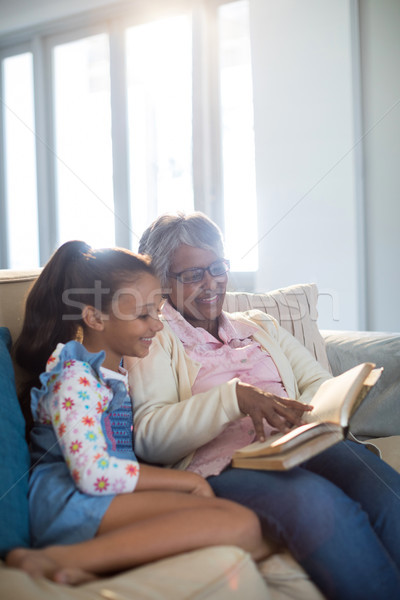 Grandmother and daughter reading book in living room Stock photo © wavebreak_media