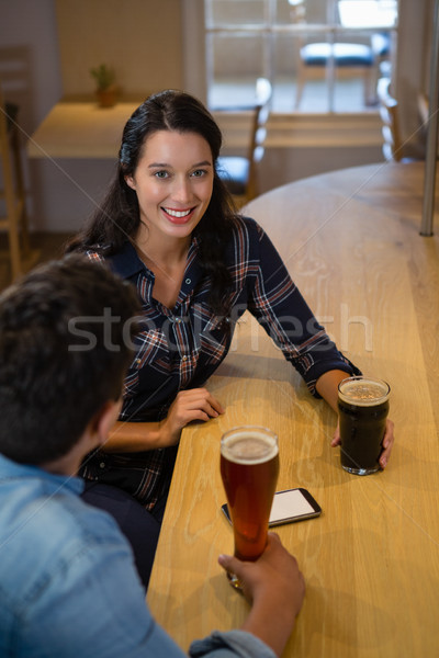Portrait of beautiful woman with friend at bar Stock photo © wavebreak_media