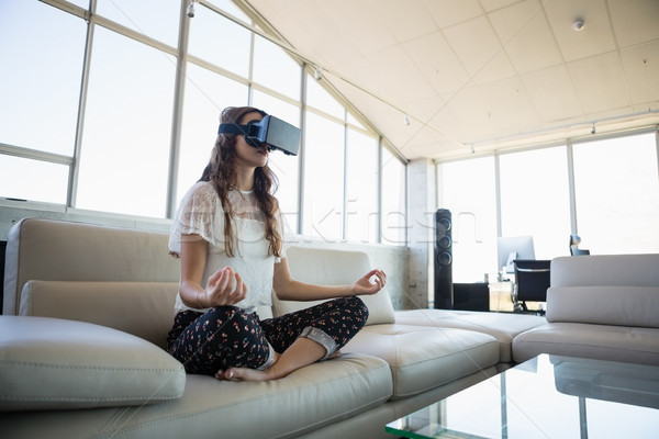 Businesswoman mediating while using virtual reality simulator Stock photo © wavebreak_media
