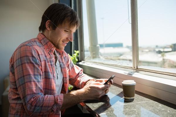 Zakenman telefoon vergadering venster jonge kantoor Stockfoto © wavebreak_media