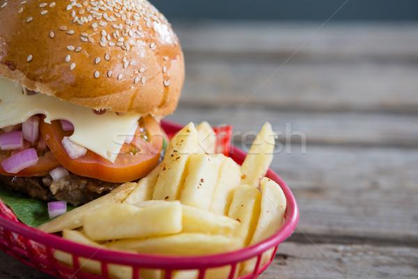Közelkép sültkrumpli sajtburger kosár fa asztal fa Stock fotó © wavebreak_media