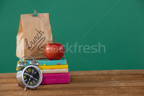 будильник обед яблоко книгах Сток-фото © wavebreak_media