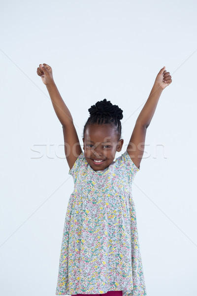 Portrait of cheerful businesswoman with arms raised Stock photo © wavebreak_media