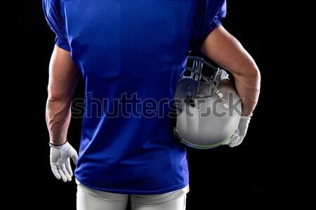 Középső rész férfi játékos tart rögbilabda áll Stock fotó © wavebreak_media