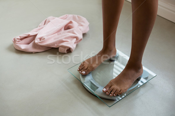 Low section of woman on bathroom scale at home Stock photo © wavebreak_media