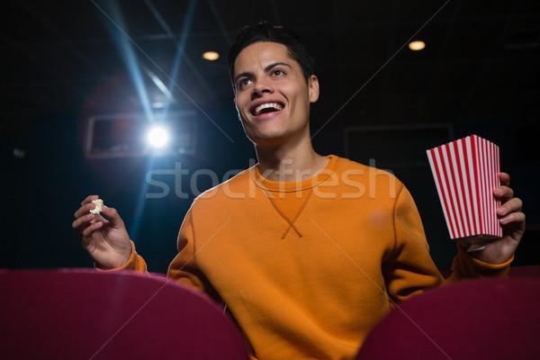 счастливым человека попкорн смотрят фильма театра Сток-фото © wavebreak_media