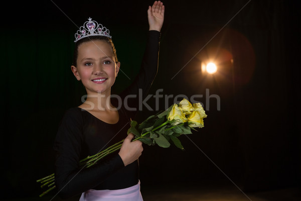 Happy ballerina posing with flower bouquet on stage in theatre Stock photo © wavebreak_media