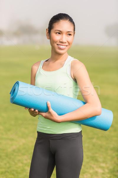 Mosolyog sportos nő tart testmozgás boldog Stock fotó © wavebreak_media