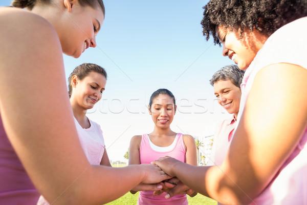 Nők visel rózsaszín mellrák kezek együtt Stock fotó © wavebreak_media
