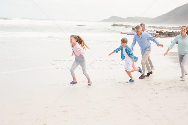 Tous ensemble plage fille homme Photo stock © wavebreak_media
