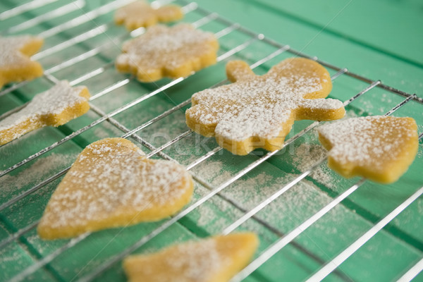 High angle view of powdered sugar on cookies over cooling rack Stock photo © wavebreak_media