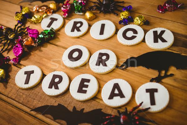 Cookie sztuczka tekst dekoracje tabeli Zdjęcia stock © wavebreak_media