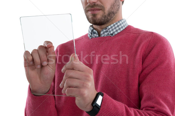 Stock photo: Mid section of man using glass digital tablet