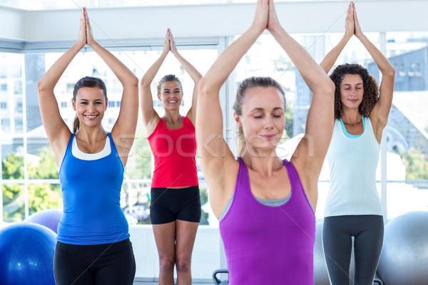 Women in fitness studio with hands joined overhead Stock photo © wavebreak_media