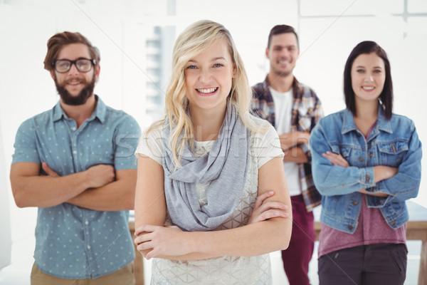 Portret fericit afaceri profesionisti cu bratele incrucisate în picioare Imagine de stoc © wavebreak_media