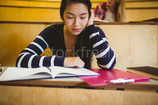 Focused student reading on notebook Stock photo © wavebreak_media
