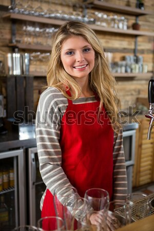 Female potter standing with arms crossed in pottery workshop Stock photo © wavebreak_media