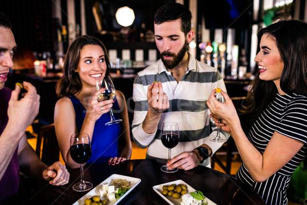 Friends having an aperitif with wine Stock photo © wavebreak_media