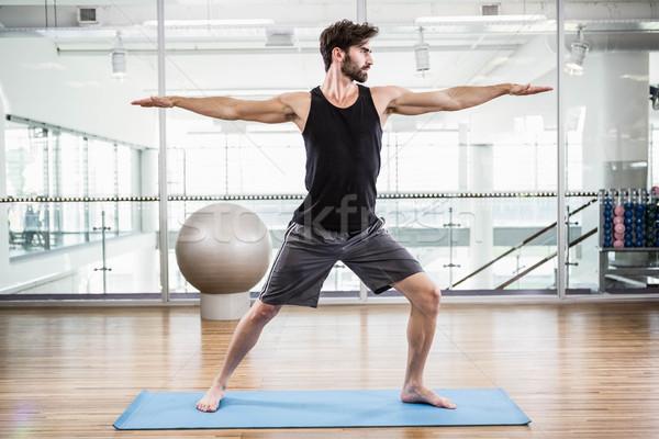 Hombre guapo estera de yoga estudio hombre deporte cuerpo Foto stock © wavebreak_media