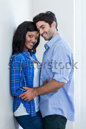 Homem tocante grávida barriga sorridente Foto stock © wavebreak_media