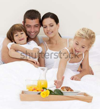 Playful siblings with parents on bed Stock photo © wavebreak_media