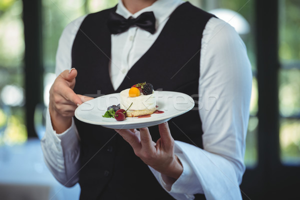Waitress holding a plate with dessert Stock photo © wavebreak_media