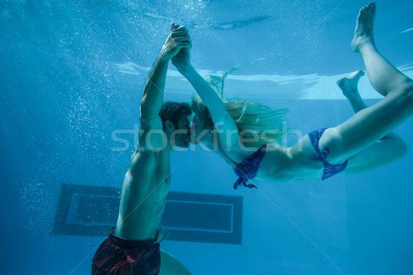 Cute Pareja besar subacuático piscina vacaciones Foto stock © wavebreak_media