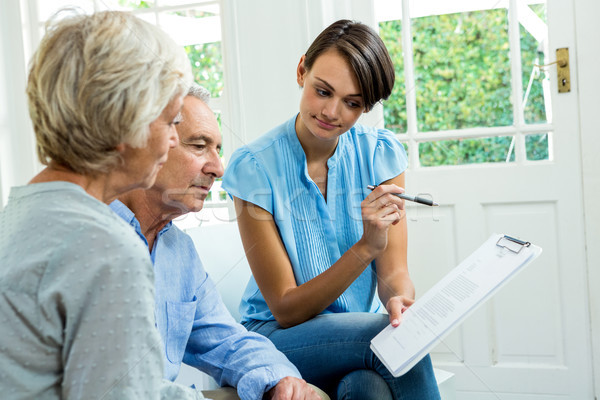 Senior couple reading report with female consultant Stock photo © wavebreak_media