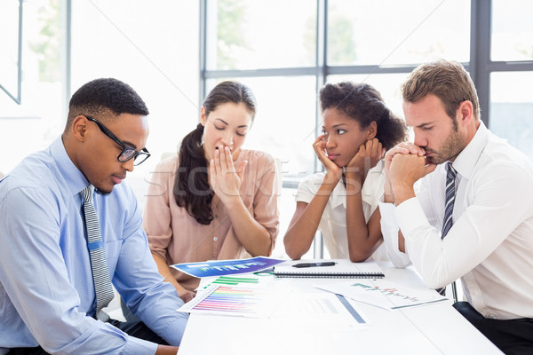 Tensed businesspeople sitting at table during a meeting Stock photo © wavebreak_media