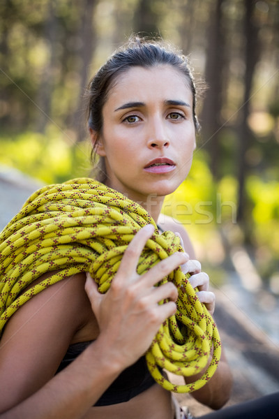 Woman unsmiling and sitting with climbing equipment  Stock photo © wavebreak_media