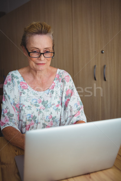 Smiling senior woman using a laptop Stock photo © wavebreak_media