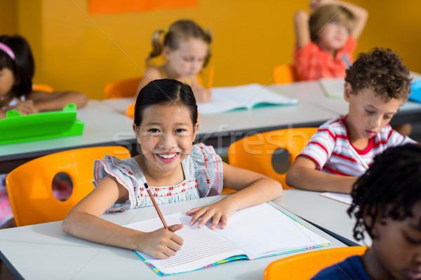 Ritratto sorridere ragazza libro panchina classe Foto d'archivio © wavebreak_media