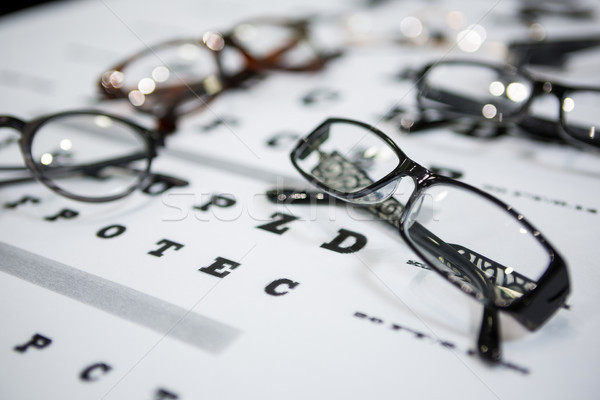 Close-up of various spectacles on eye chart Stock photo © wavebreak_media