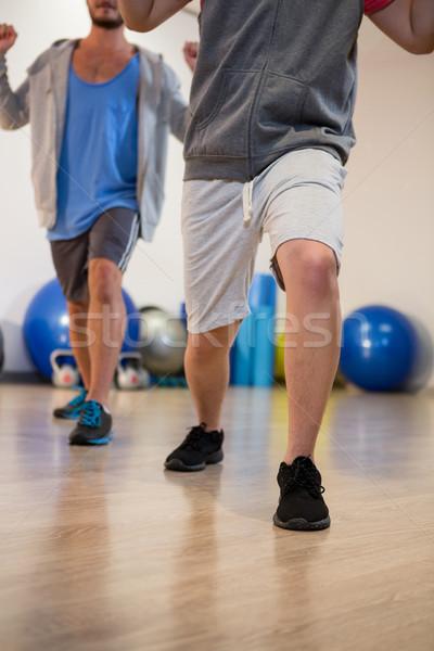 Men performing stretching exercise Stock photo © wavebreak_media
