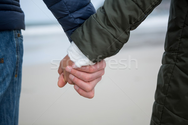 Close-up of couple holding hands on the beach Stock photo © wavebreak_media