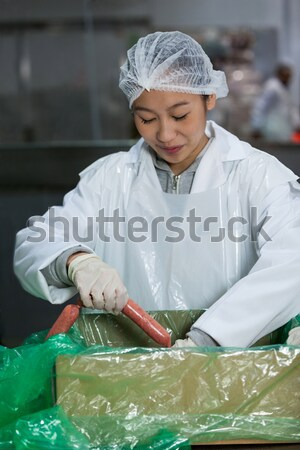 Female butchers processing sausages Stock photo © wavebreak_media