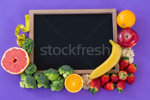 Slate arranged with various fruits and vegetable Stock photo © wavebreak_media