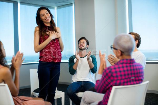 Creative business team applauding their colleague Stock photo © wavebreak_media