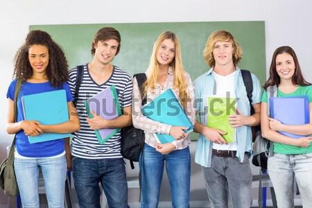 Boldog főiskola diákok tart mappák fehér Stock fotó © wavebreak_media