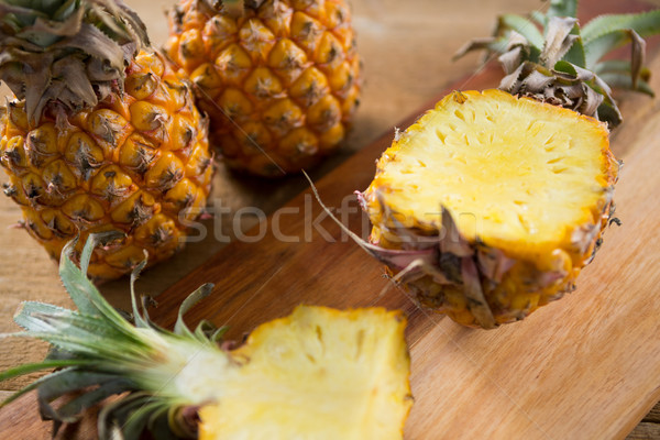 Close-up of halved pineapple on chopping board Stock photo © wavebreak_media
