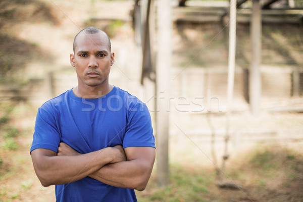 Portrait of fit man standing with arms crossed during obstacle course Stock photo © wavebreak_media