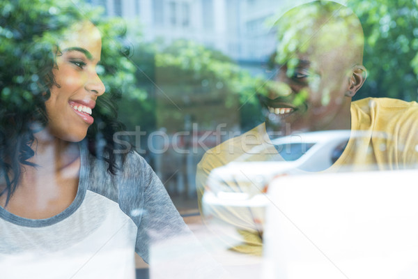 Couple looking at each other in coffee house seen through window Stock photo © wavebreak_media
