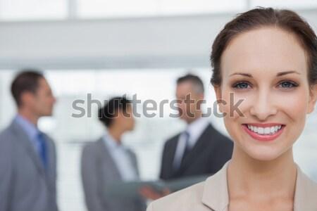 привлекательный деловая женщина коляске улыбаясь камеры бизнеса Сток-фото © wavebreak_media