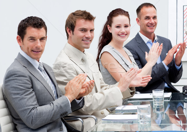 Stock photo: Business team applauding in a meeting