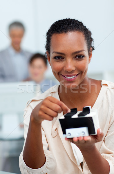 Stock photo: Cheerful busineswoman searching for the index