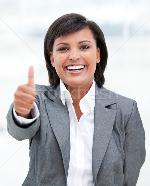 Portrait of a fortunate business woman with a thumb up Stock photo © wavebreak_media