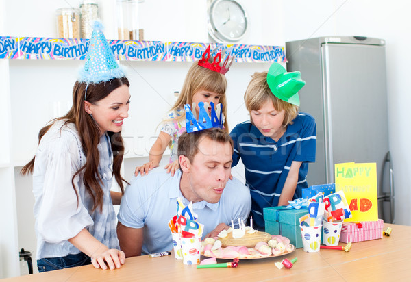 Elegant man celebrating his birthday with his wife and his child Stock photo © wavebreak_media