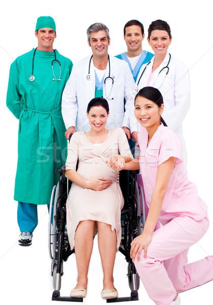 Mulher grávida sessão cadeira de rodas ajuda médico equipe Foto stock © wavebreak_media